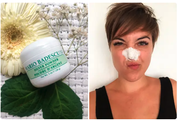 A BuzzFeed writer with the silver powder applied to the bridge of her nose