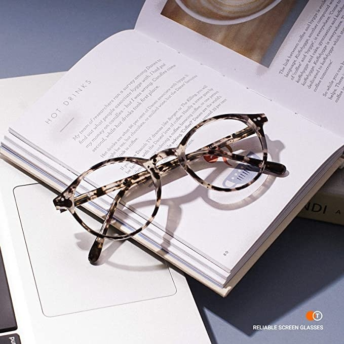A pair of glasses on a book