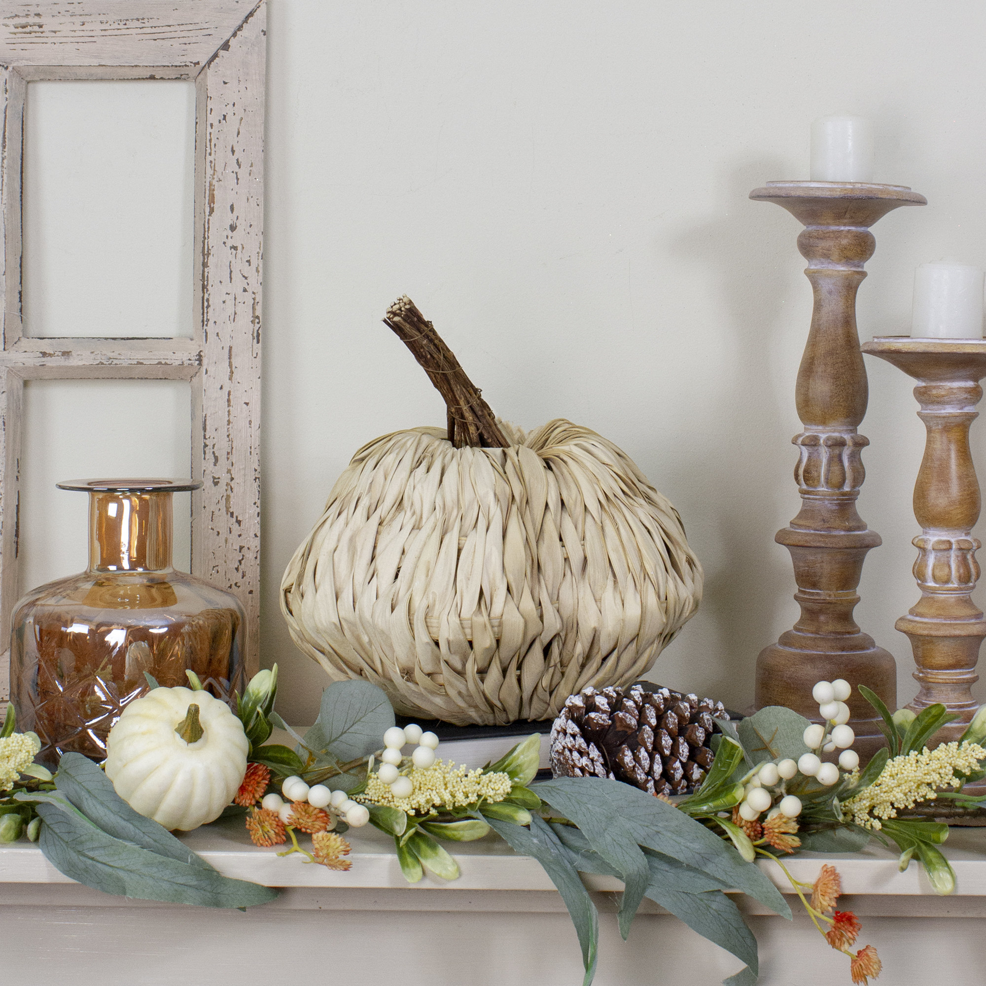 The woven pumpkin displayed on a mantle