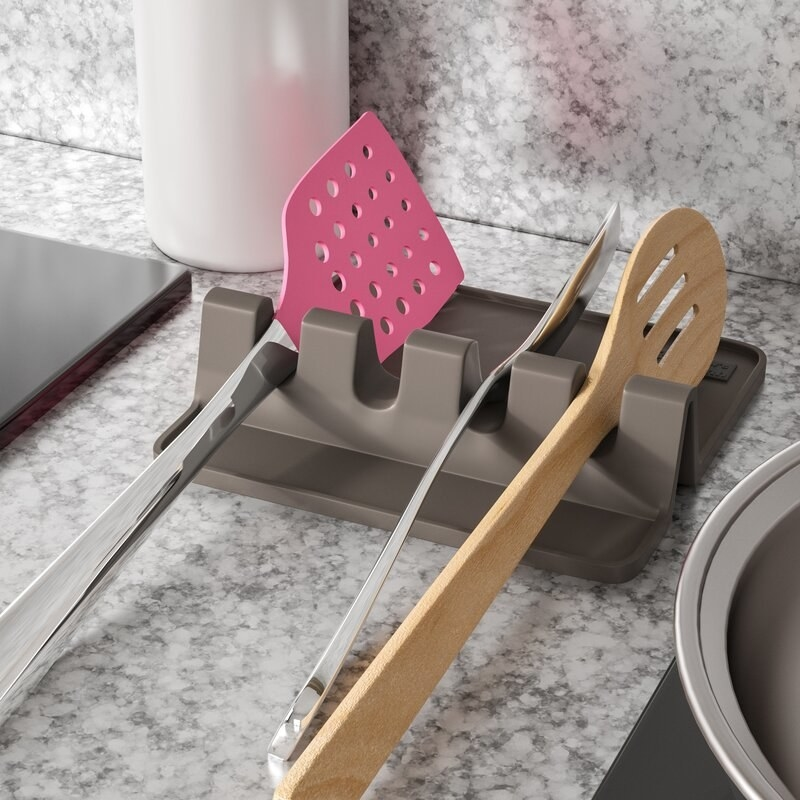 A slate-colored spatula and spoon holder for cooking