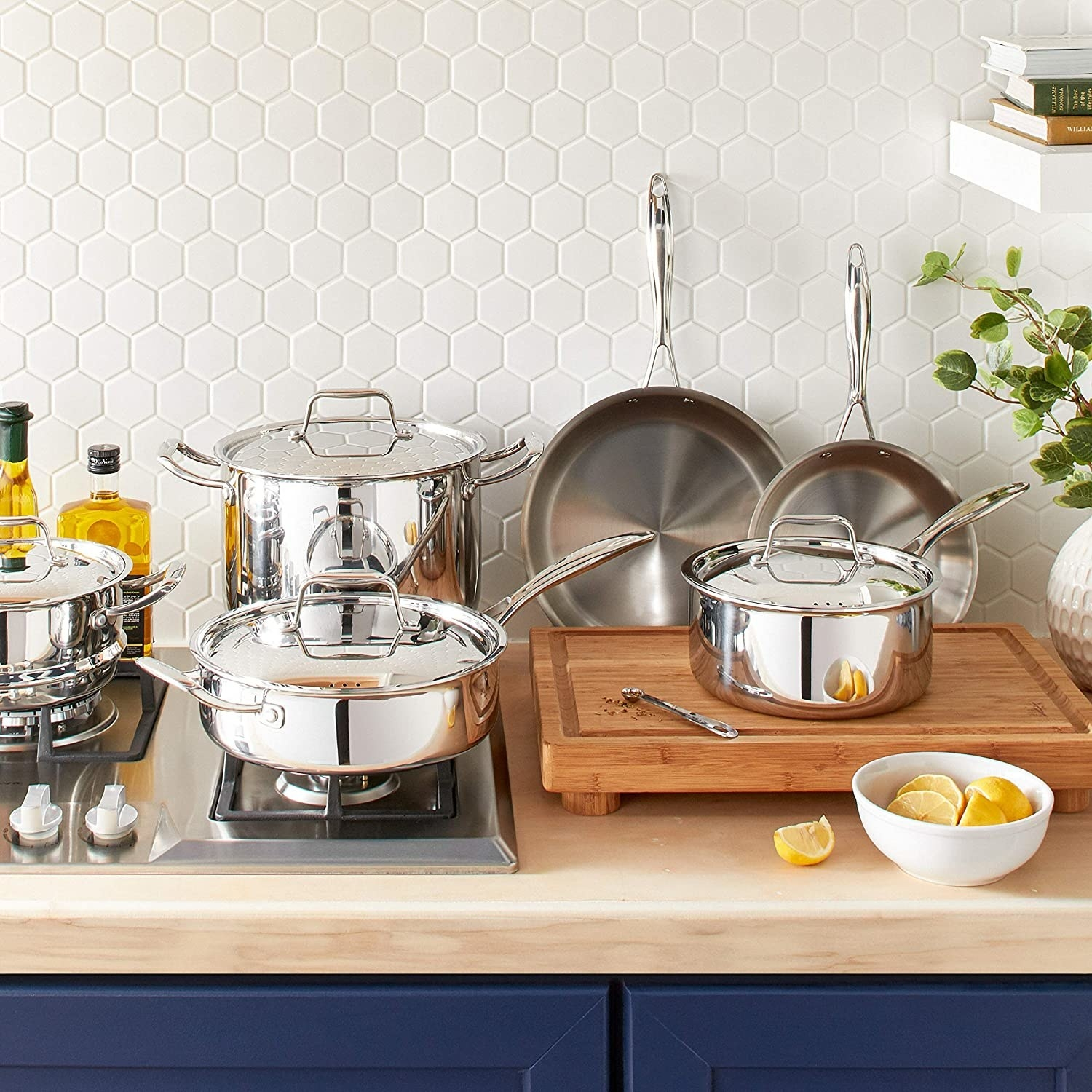 The set of cookware arranged on a butcher block counter