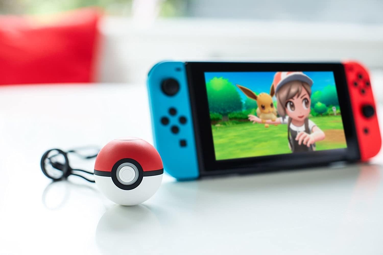 the pokemon ball next to a nintendo switch