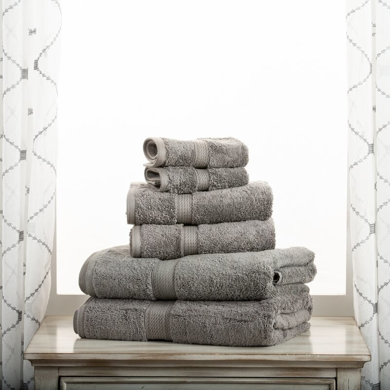 A stack of gray towels on a table