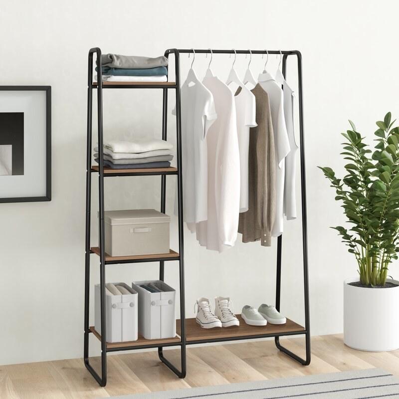 black garment rack with shelves on the side