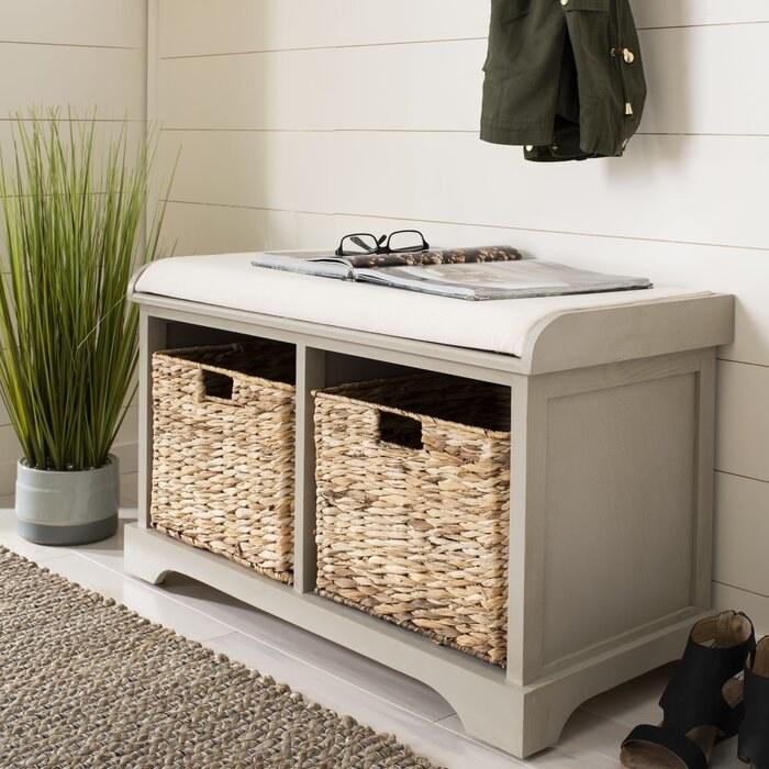 light wood storage bench with wicker baskets below