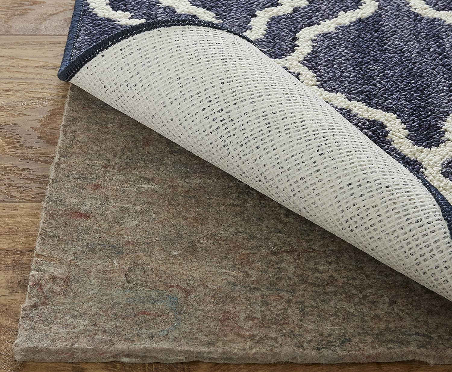 Rug with a gray mat under it