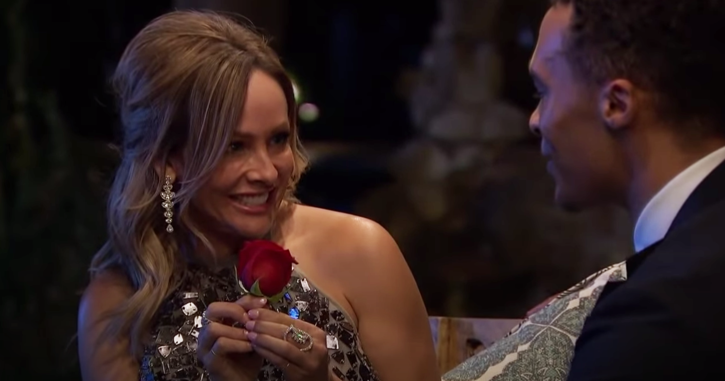 Clare smiles as she offers Dale the rose