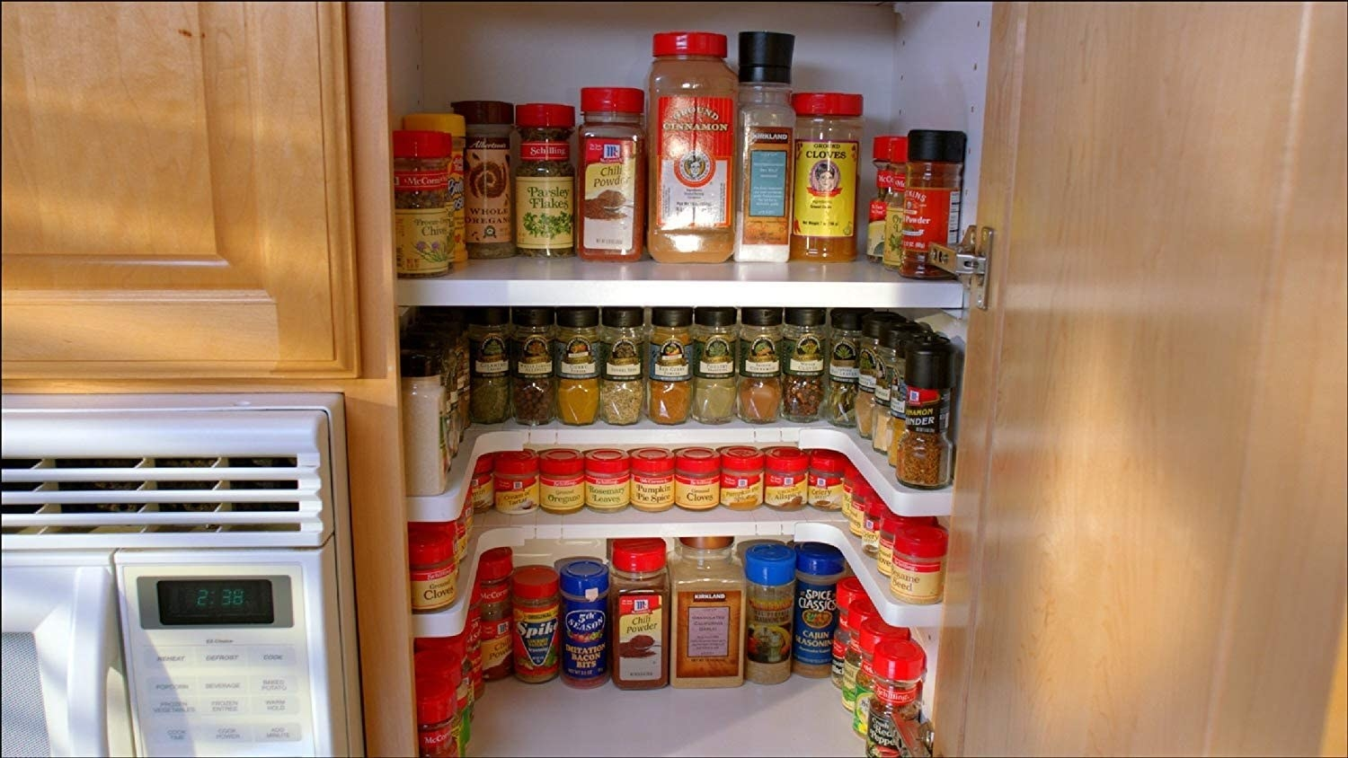 spices in a U-shaped shelving unit in a cabinet