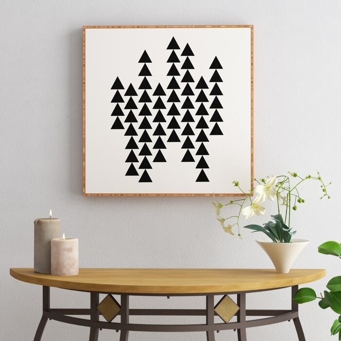 black triangular graphic art print framed with bamboo