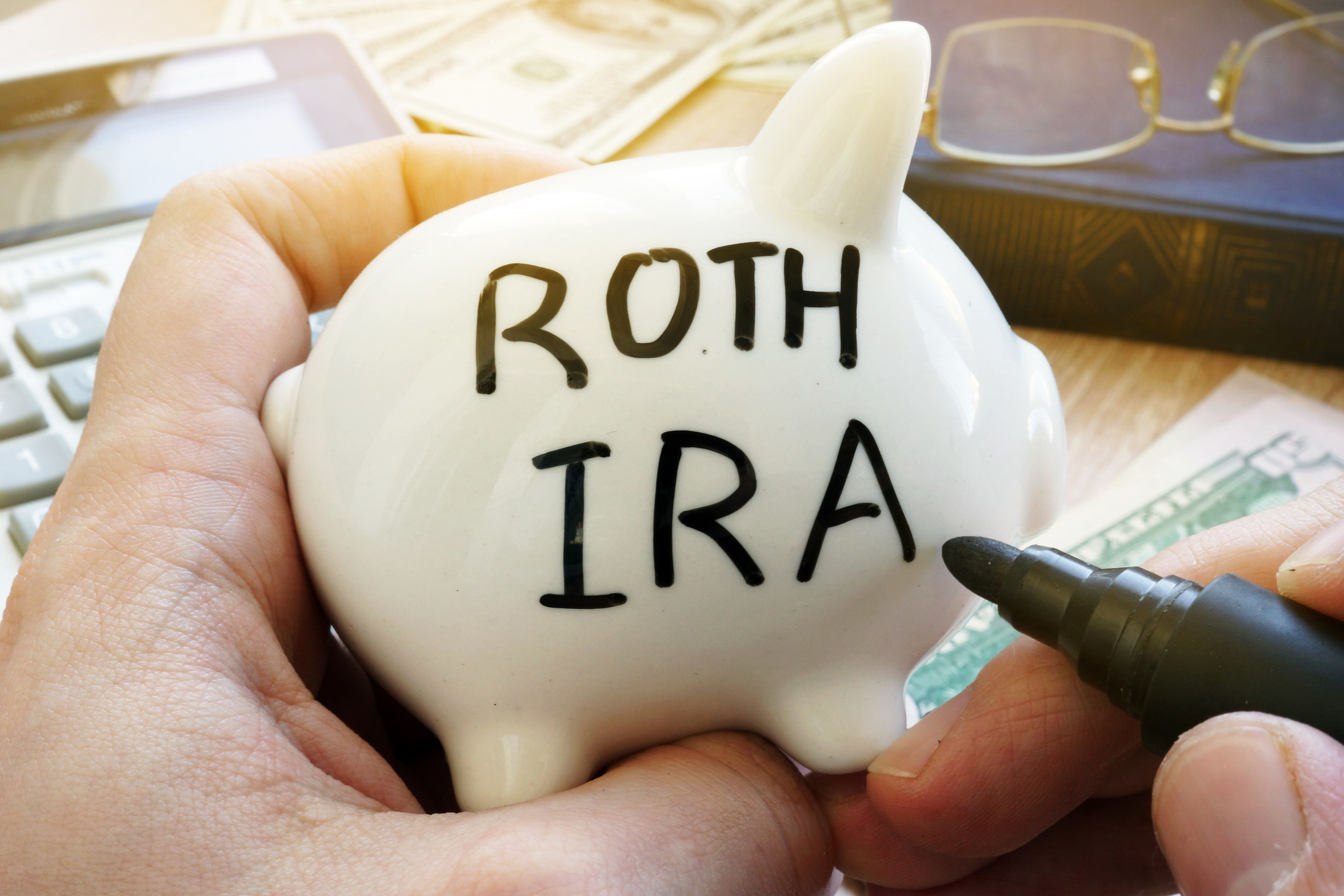 "A piggy bank with the words ""Roth IRA"" written on it"