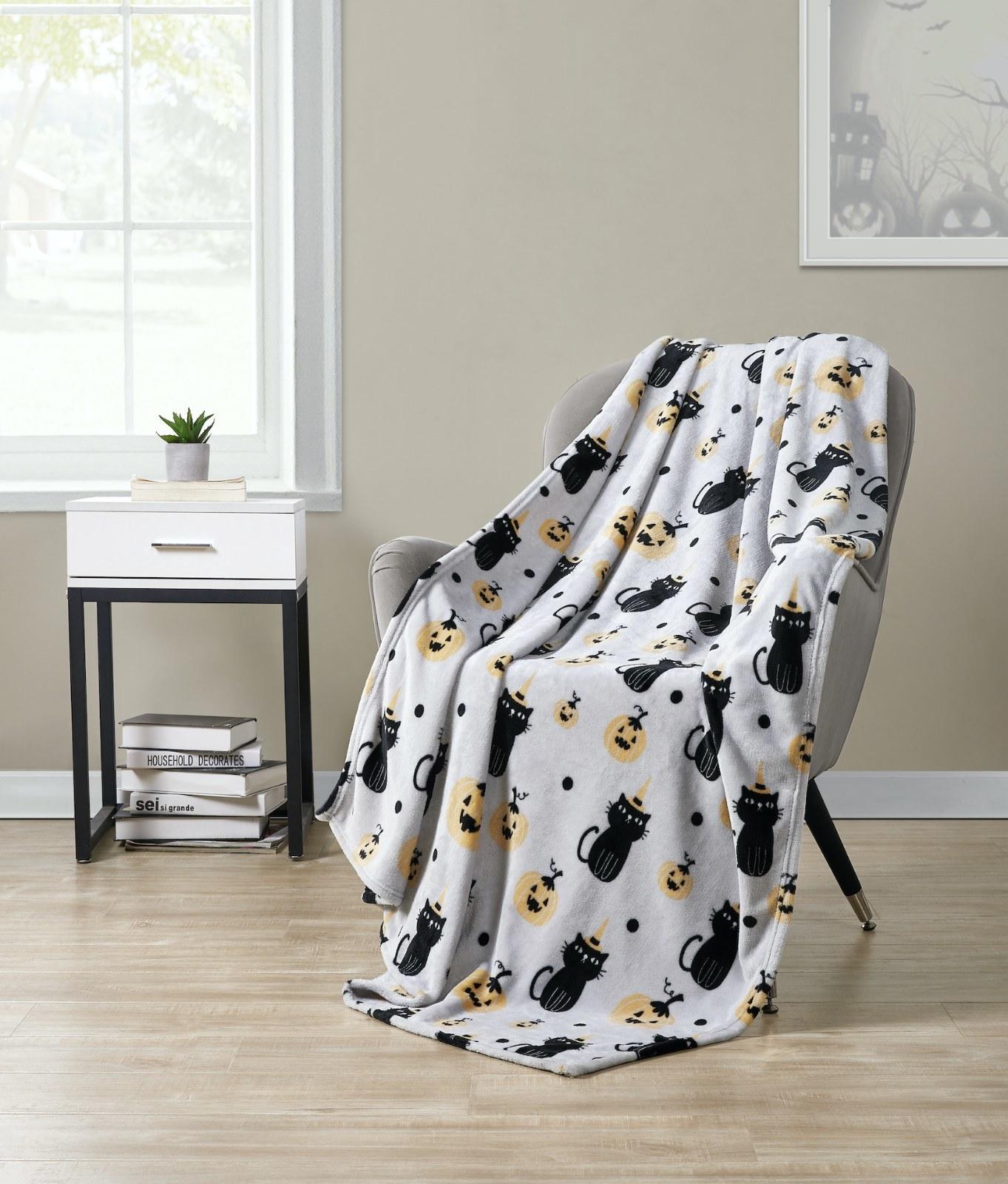 Halloween blanket displayed on armchair