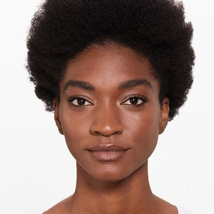 A model with no blemishes wearing the foundation