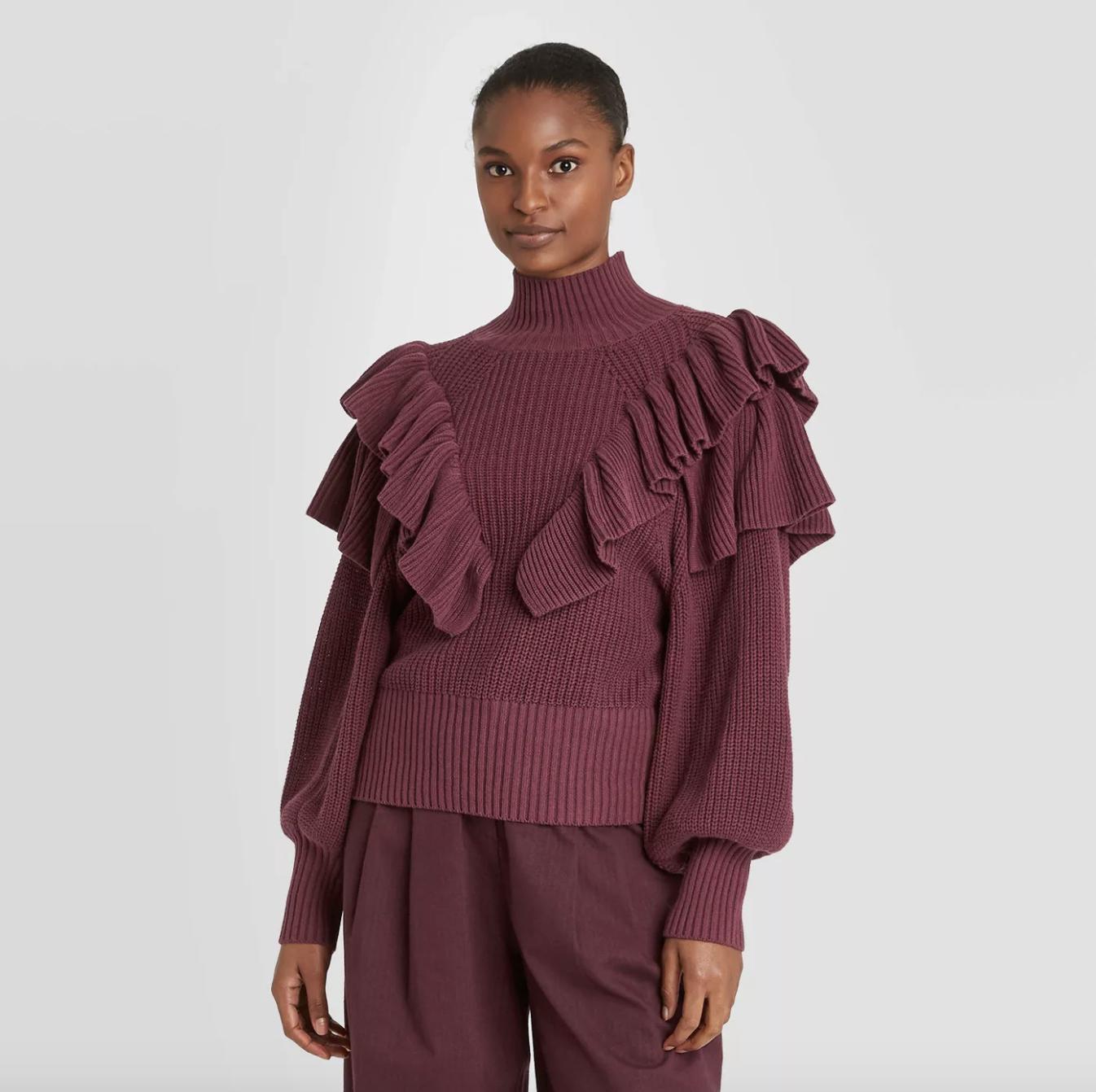 model wearing the ruffle sweater in burgundy