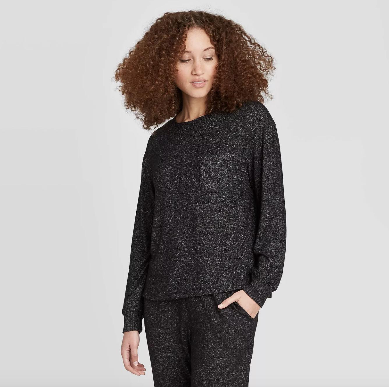 model wearing the lounge sweatshirt in charcoal