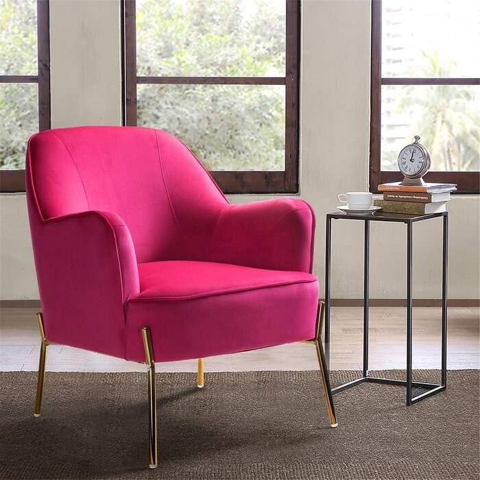 bright pink velvet armchair in a living room