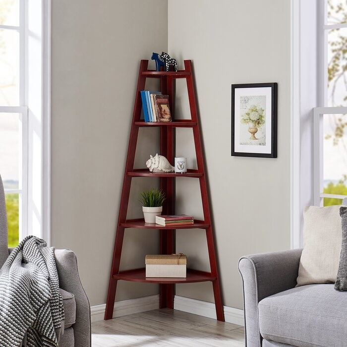 cherry wood corner bookcase in a living room