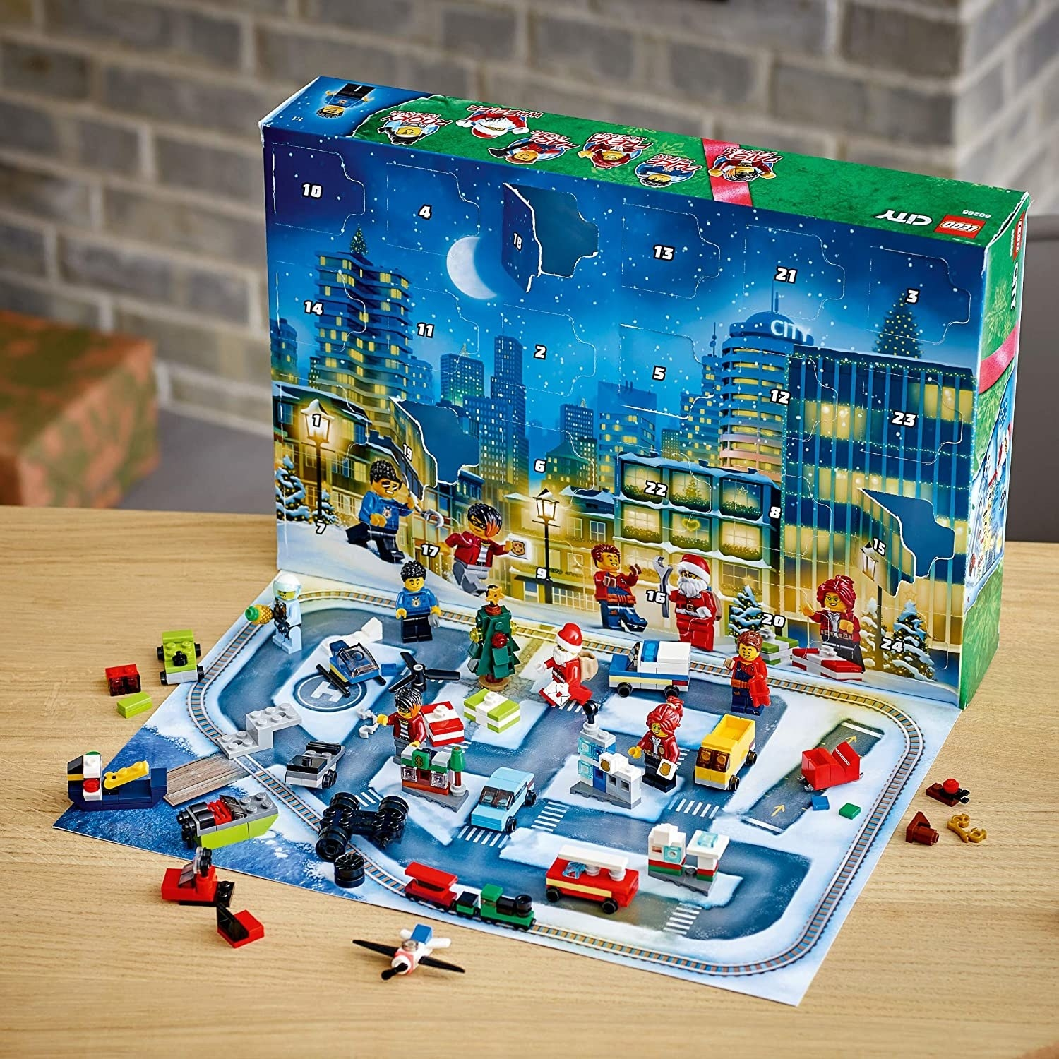 Opened Lego package with a holiday-themed city scene and small toys and figures