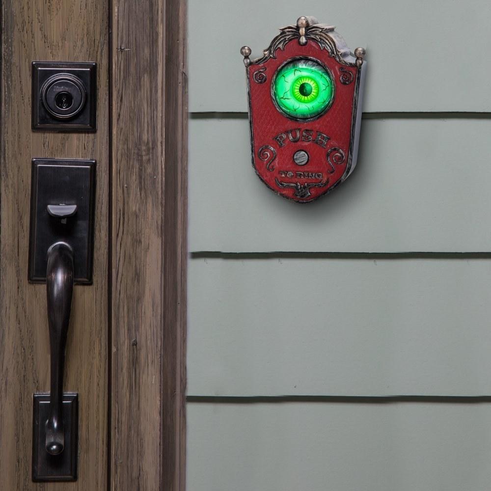 Animated eyeball doorbell next to front door