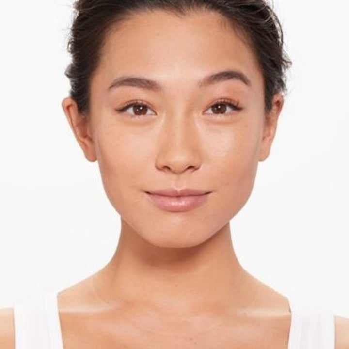 A model with hydrated skin wearing the foundation