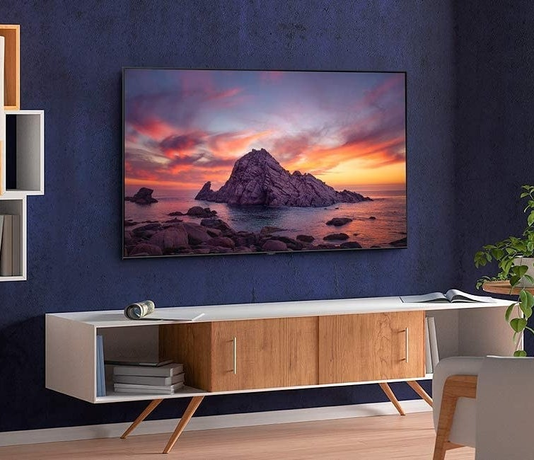 The flat screen smart TV hanging on a wall in a living room