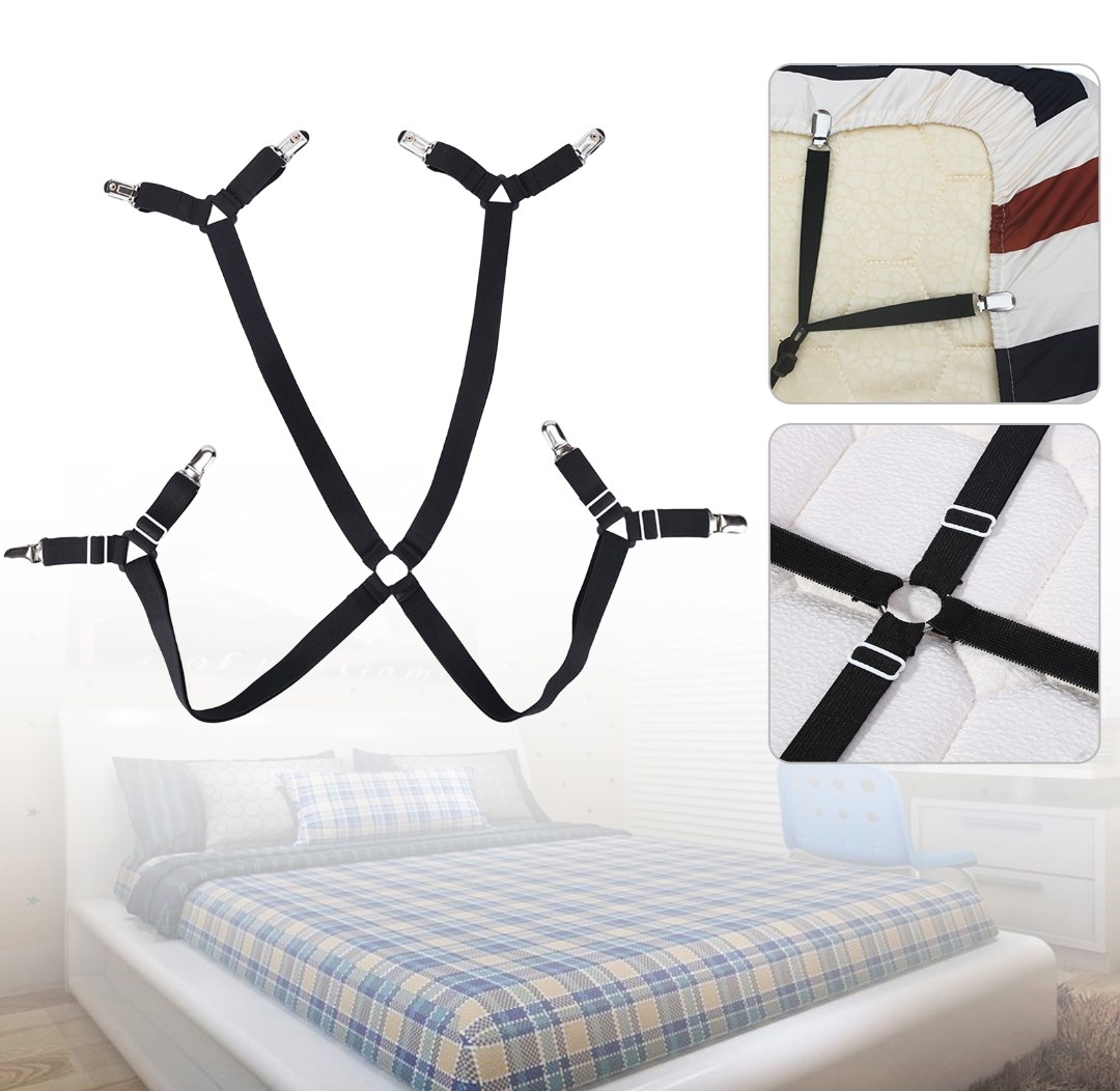 The fitted sheet suspender in black with clips
