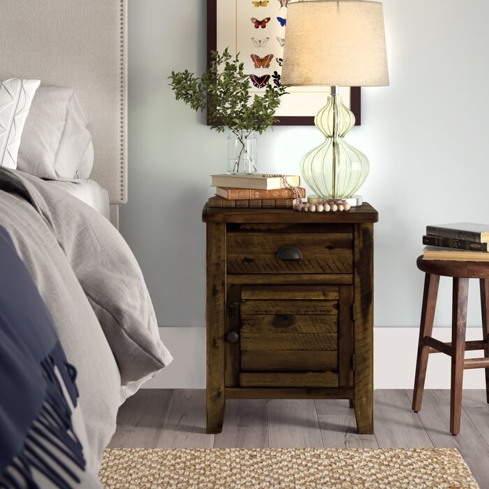 wooden nightstand with a drawer and cabinet