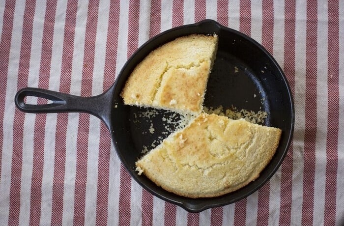 cast iron skillet with cornbread in it