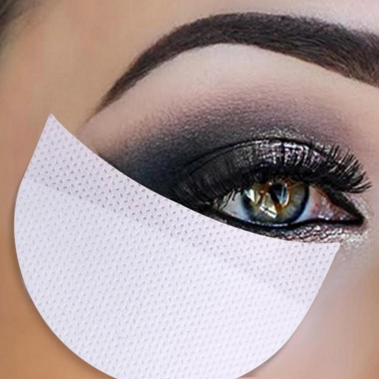 The undereye sticker makeup patch being used to catch makeup