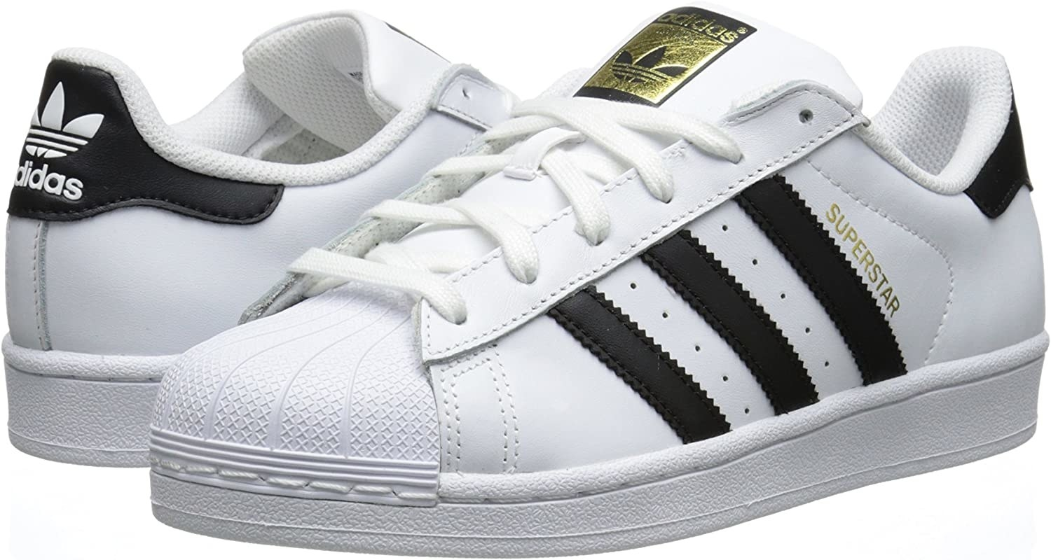 white adidas sneakers with three black stripes on the side