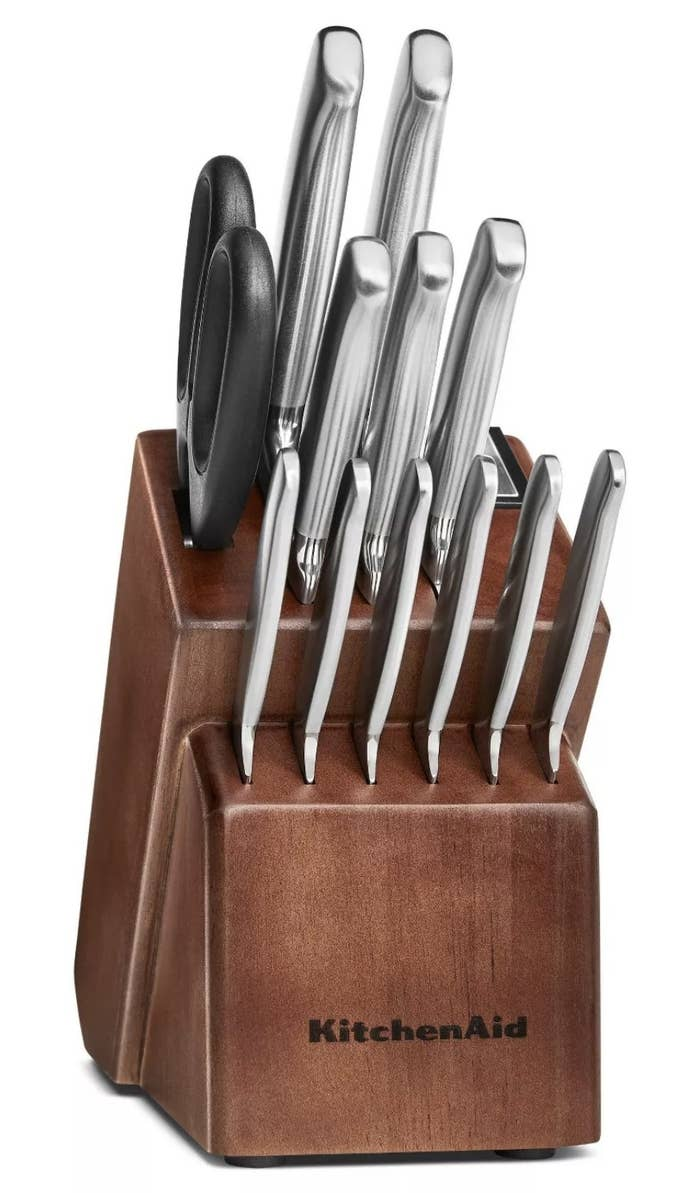 a 14 piece stainless steel knife set in a dark brown vessel