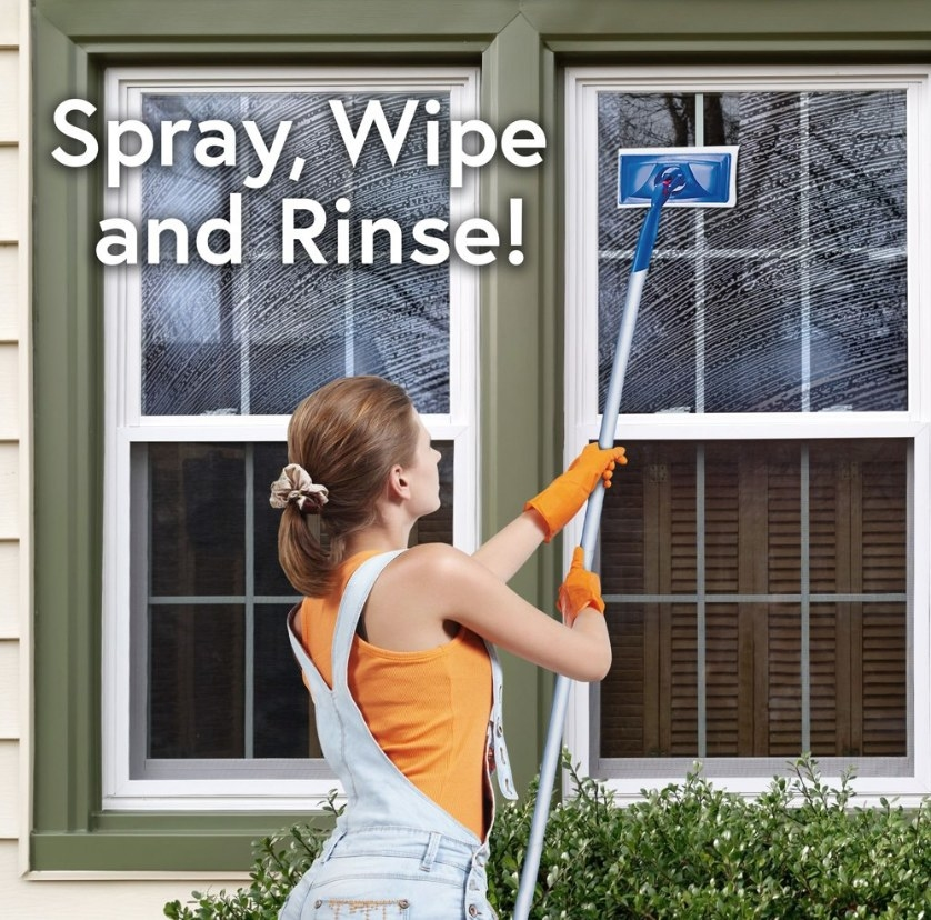 Model wearing orange shirt and orange gloves using Windex glass cleaner with extended handle on outside window