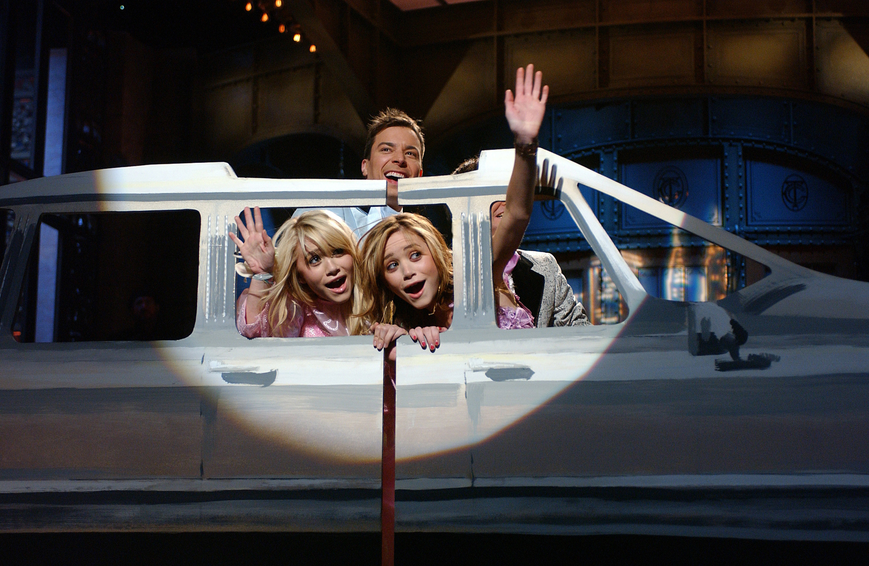 Mary-Kate and Ashley riding in a fake limo with Jimmy Fallon.