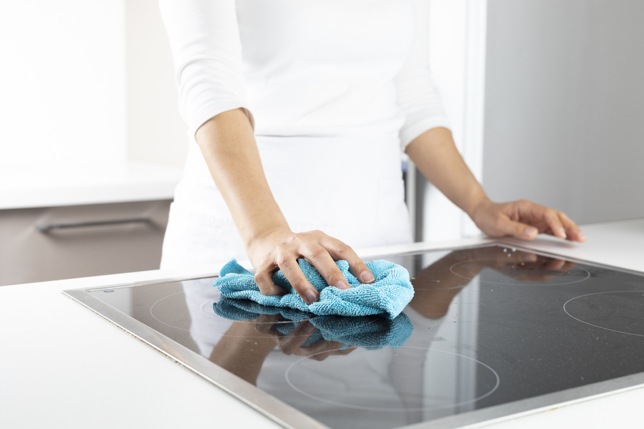 A hand scrubbing a counter
