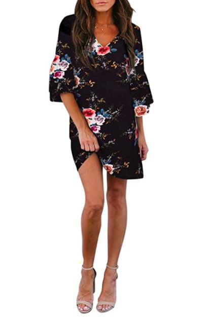 Model wears dark blue floral bell-sleeve shift dress with kitten heels