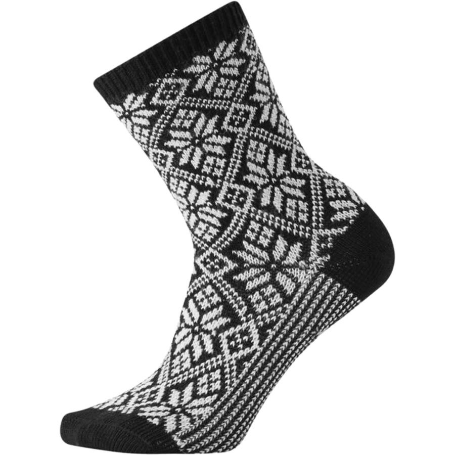 The socks in black and white with a Fair Isle knit snowflake pattern