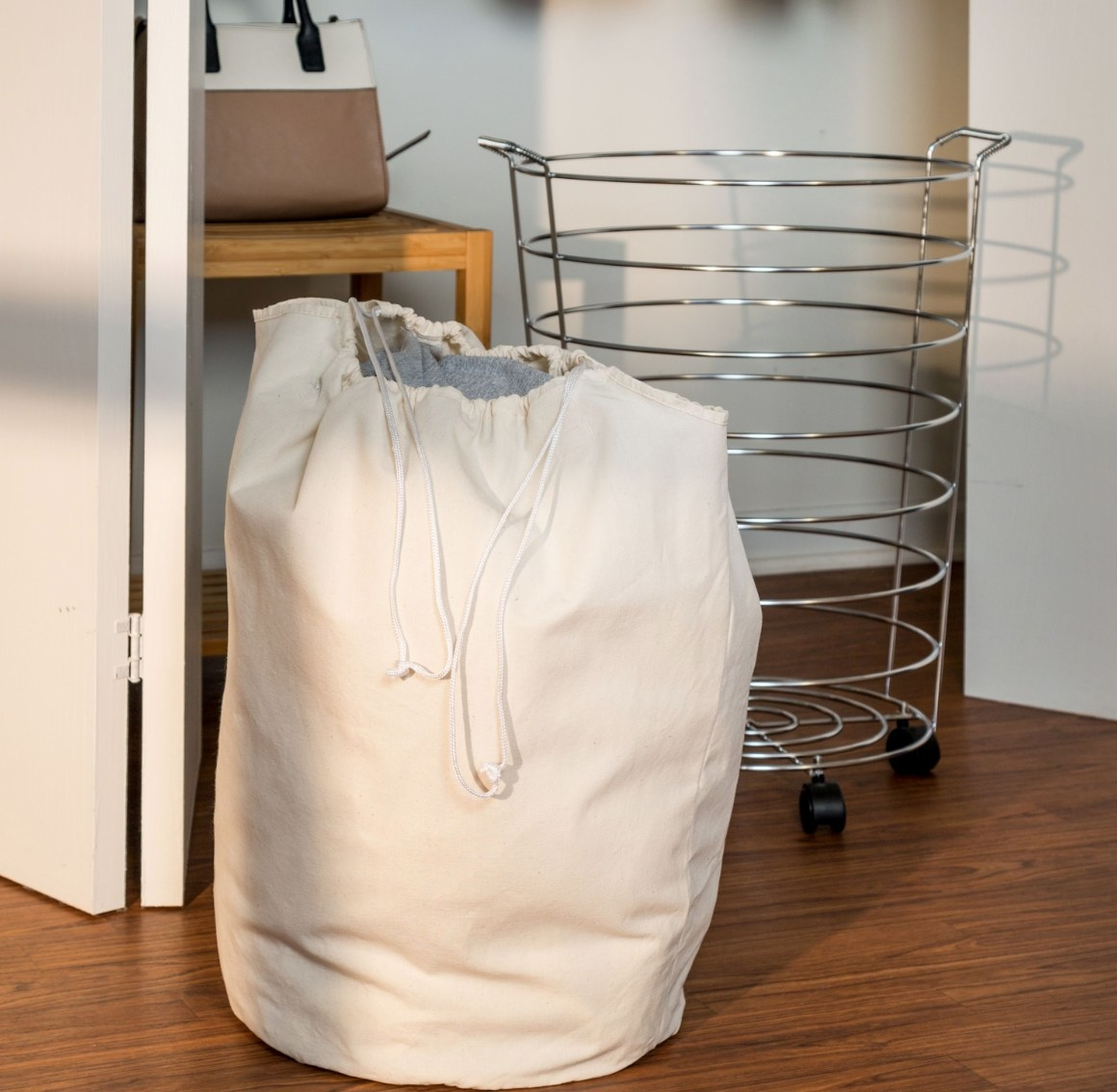 The metal  rolling hamper with removable beige liner