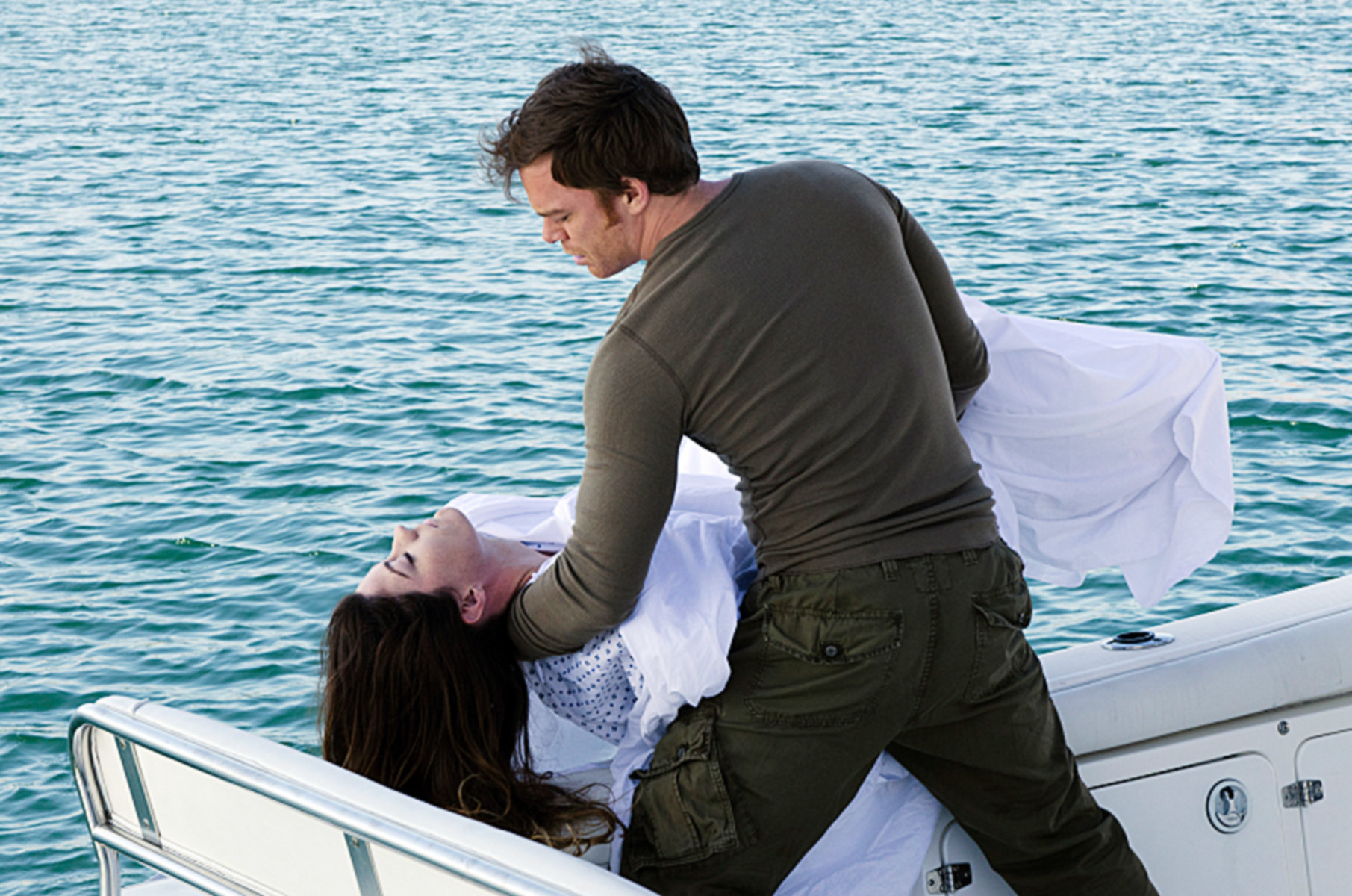 Dexter holding Deb's body, about to dump her into the water