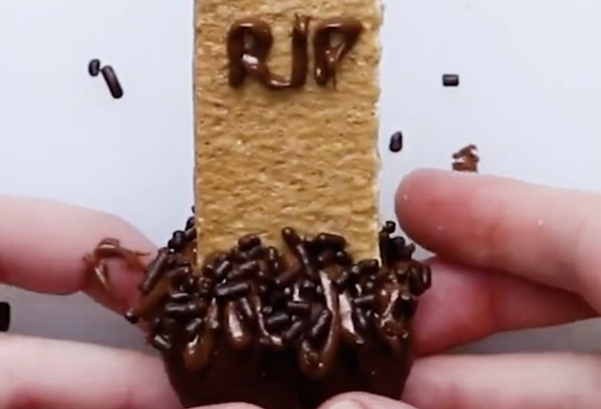 """A brownie bite with a graham cracker sticking out that says """"RIP"""""""