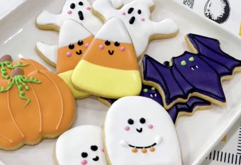 Halloween cookies shaped like cute ghosts, bats, pumpkins and candy corn