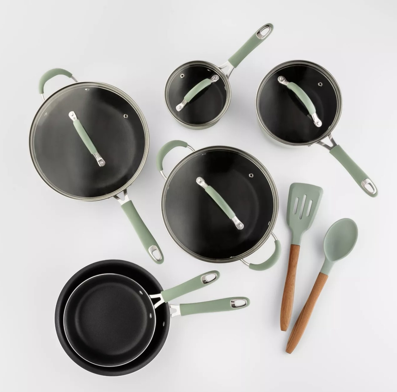 a 12 piece set of mint-handled aluminum pots