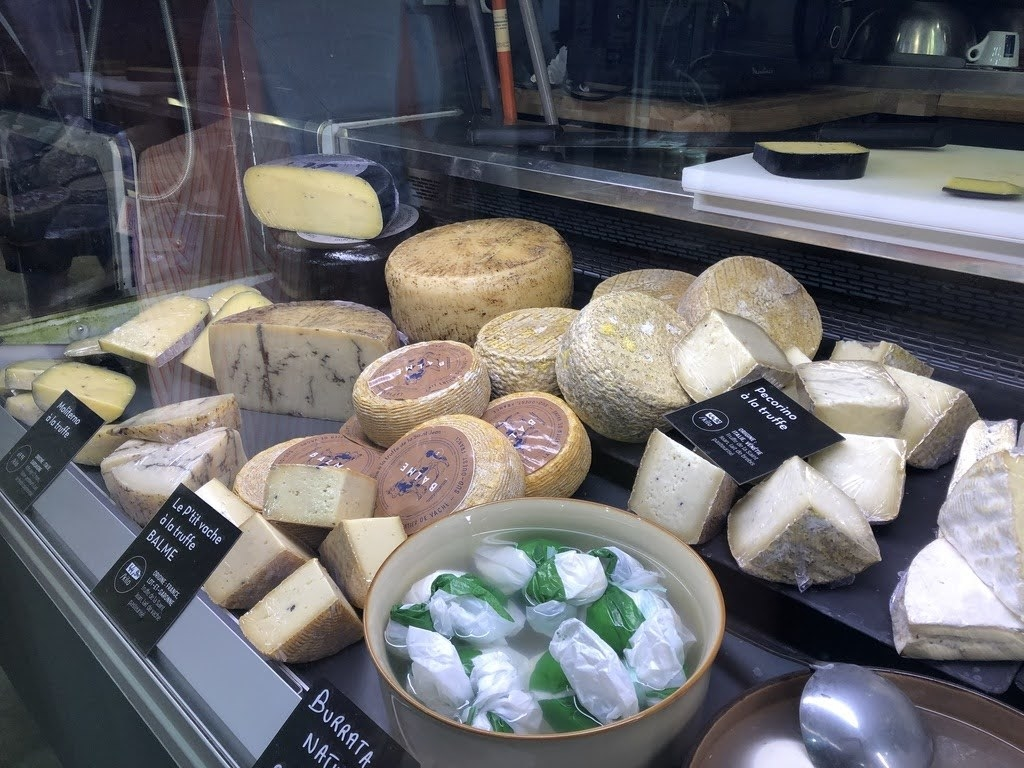 Six types of cheese in a display cooler