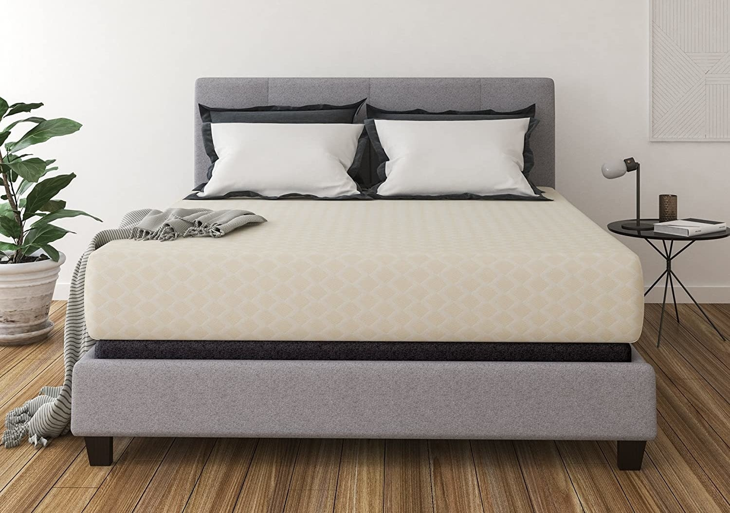The mattress on top of a bed