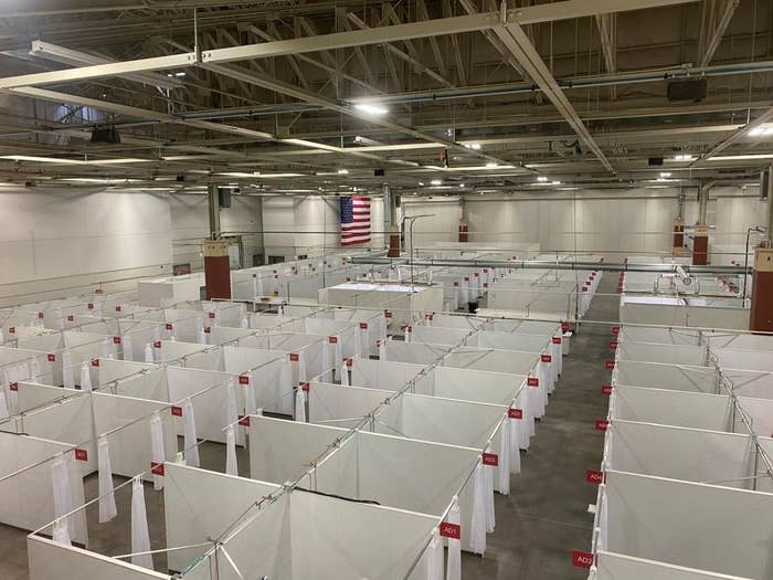 Photo showing rows of booths each intended to house a single COVID-19 patient