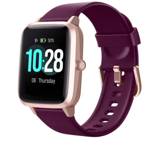 Purple and gold fitness tracker with time on the front screen