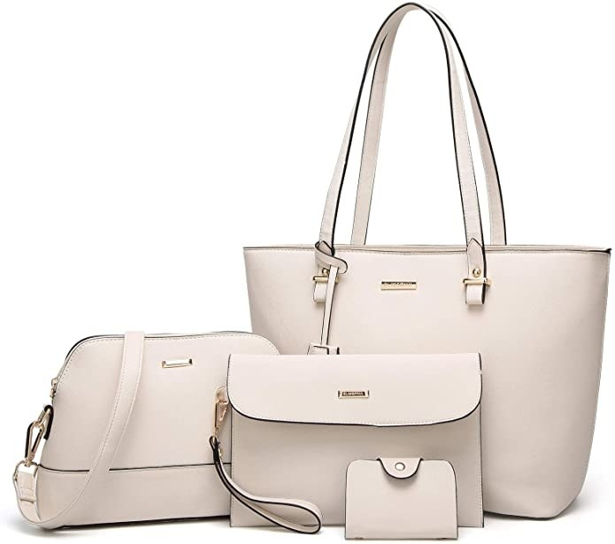 Four piece set in white with a tote, cross body, clutch, and wallet purse