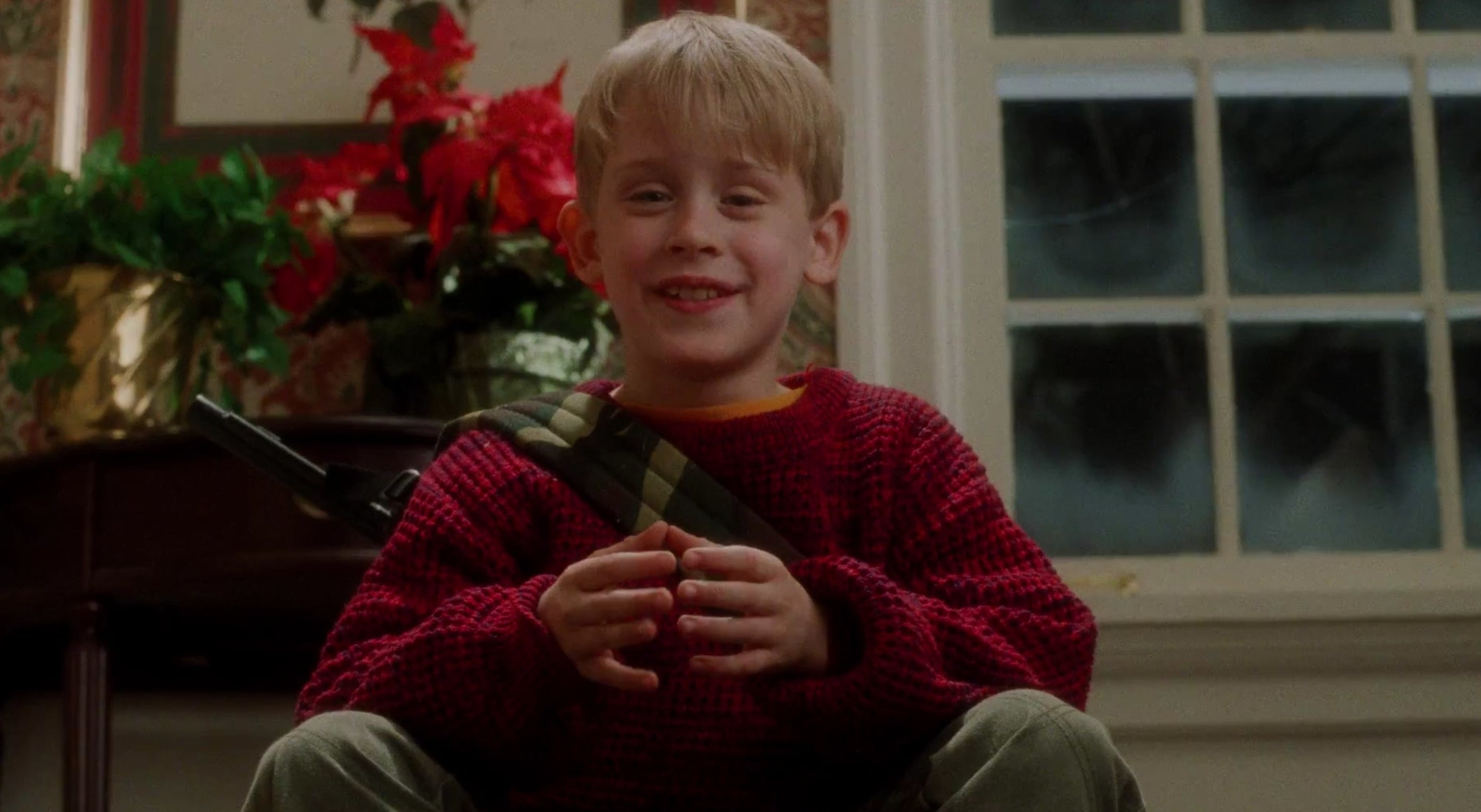 A boy in a red sweater