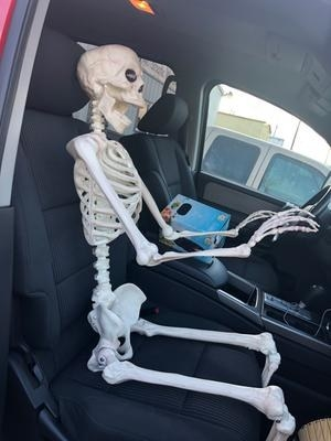 Walmart customer puts skeleton figurine in passenger seat of car