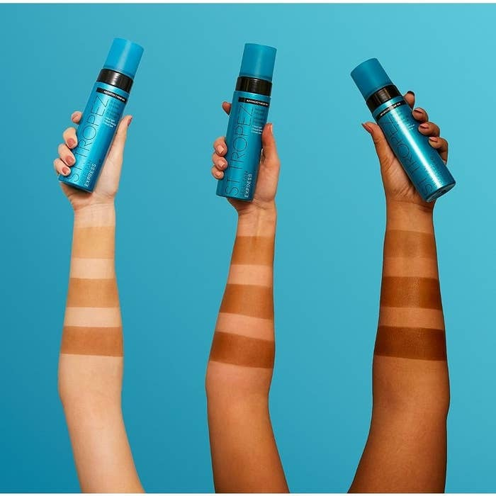 Three models wearing the deepening shades of the bronzing mousse