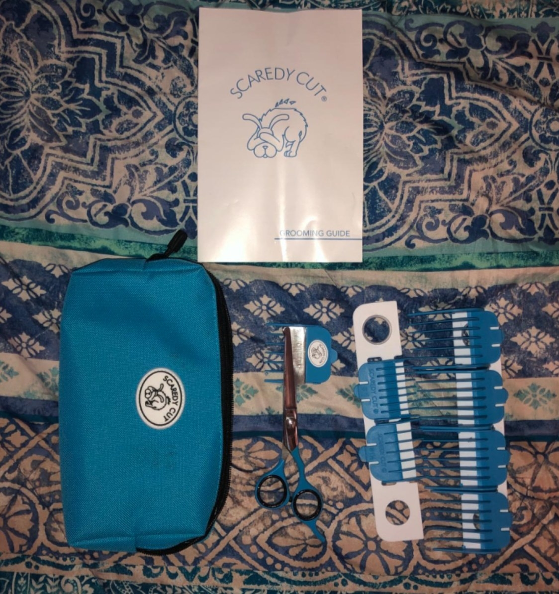 The reviewer's image of the pet grooming kit in blue