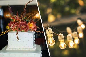 A flower-topped wedding cake next to a strand of lightbulb string lights